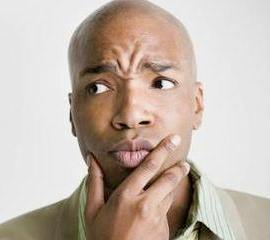 confused-black-man-green-shirt-400x2951